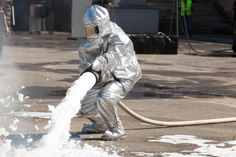 someone pouring a spray foam