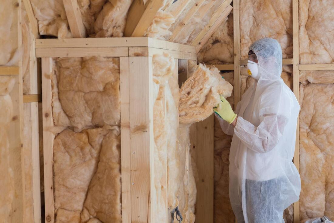 man removing all the insulation
